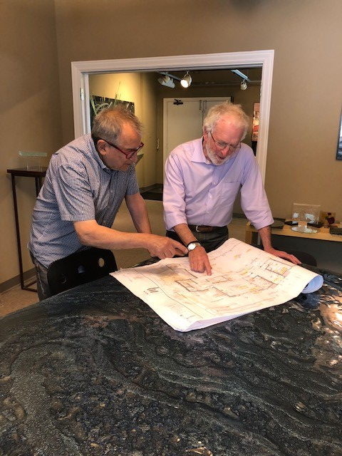 Steve and Norm Sandler, AIA, reviewing architectural plans